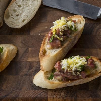Steak Tartare Crostini with Shaved Egg and Chives CMS